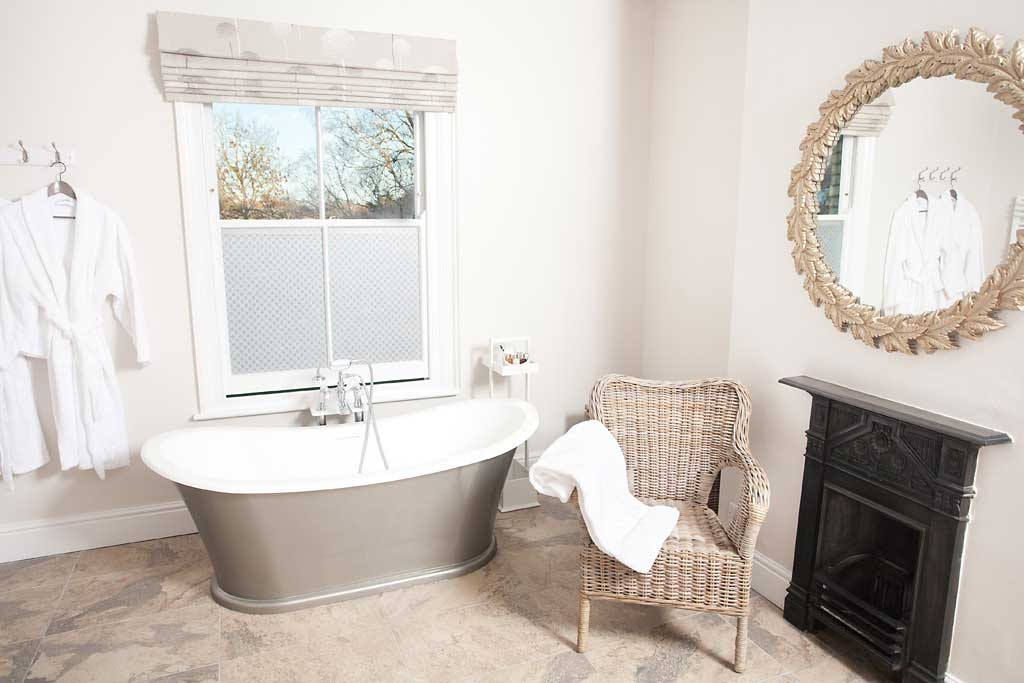 En suite bathroom with freestanding bateau bath and large separate shower